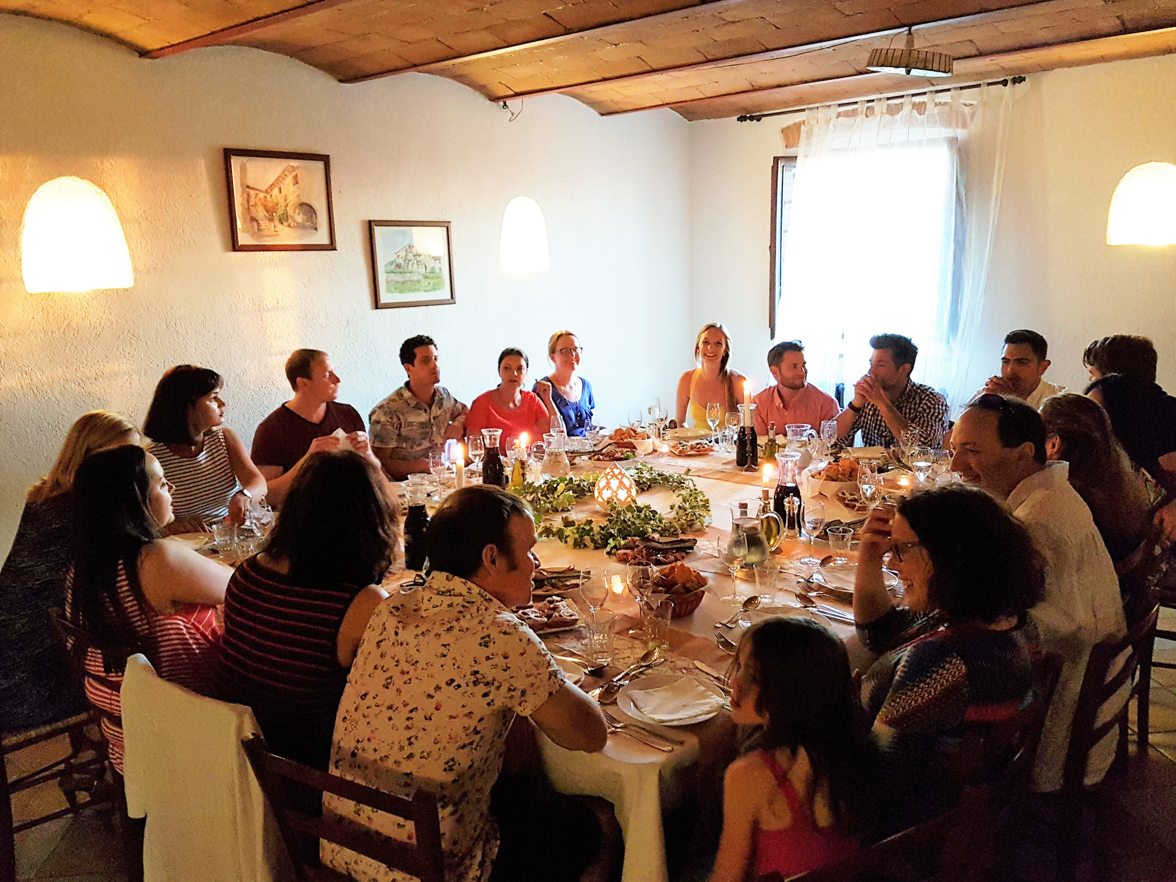 Guests at our agritusmo villa rental in Chianti having fun at our weekly Tuscan Banquet